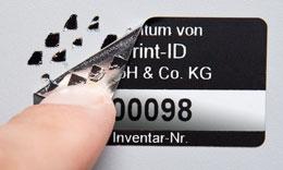 Inventaretikett mit silberner Folie und Schachbrett-Sicherheitskleber